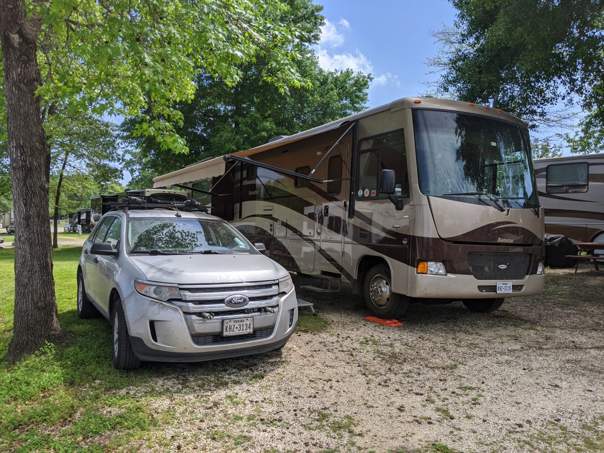 My motorhome and car parked at Escapee's Rainbow's End